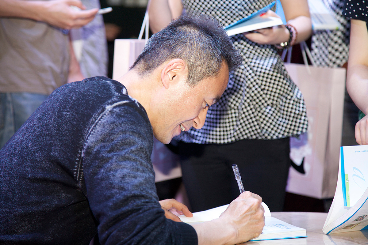 Kobayshi was signing his book.