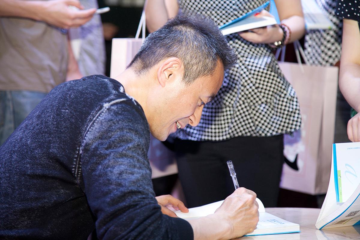 Kobayshi was signing his book.